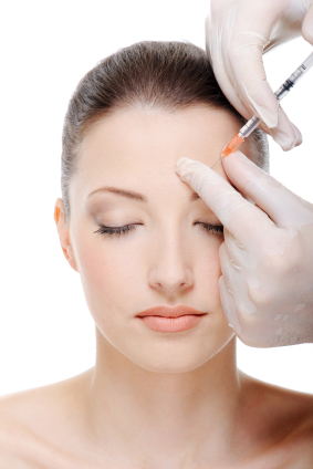Woman having glabella injected with Botox